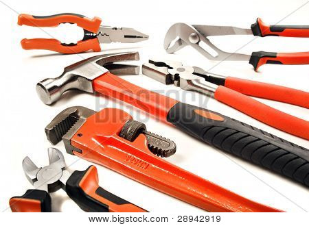 New tools - hammer pliers and a wrench on a white background with space for text