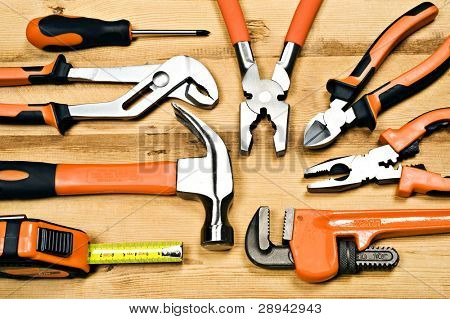a Set of tools consisting of pliers, a hammer screwdrivers