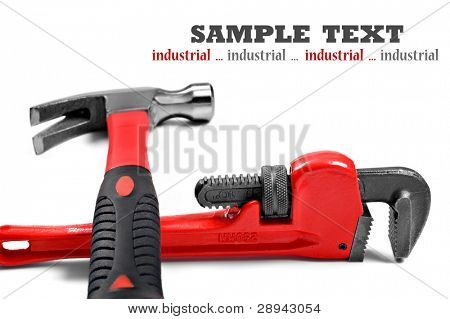 New hammer and wrench on a pure white background with space for text - shallow depth of field