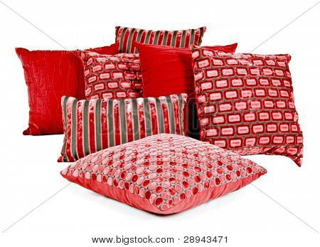 Combination of red and brown pillows on a white background