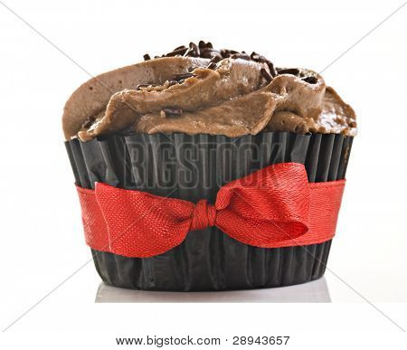 Close up of one chocolate cupcake on white backgroudn