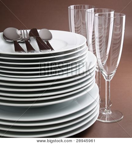 plate stack , cutlery and glasses
