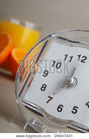 time of breakfast, alarm clock and orange juice