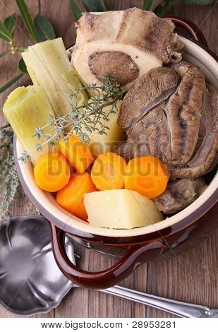 stewpot with beef stew and vegetables