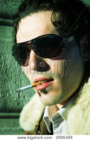 Sexy Young Man Smoking Cigarette