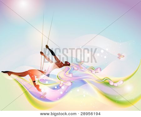 Young woman on the swing in springtime