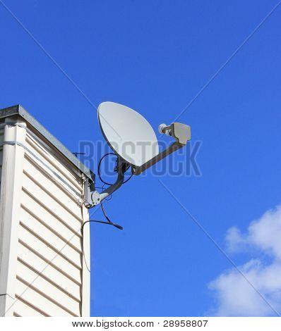 Satellite Dish on Chimney over Blue Sky
