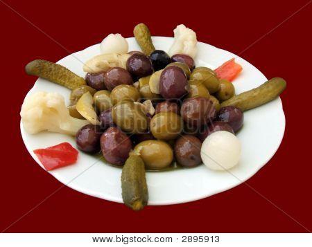 Plate Of Mixed Olives & Pickles/Pickle. Appetizer. Brine. Preserves.