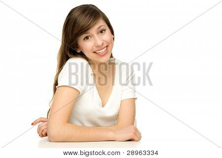 Woman with arms leaning on table