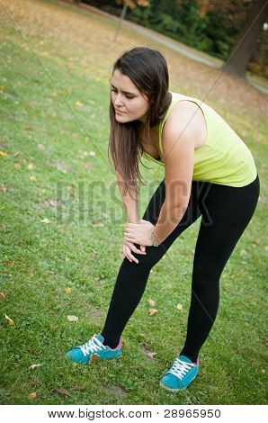 Knee Injury - Woman In Pain After Sport