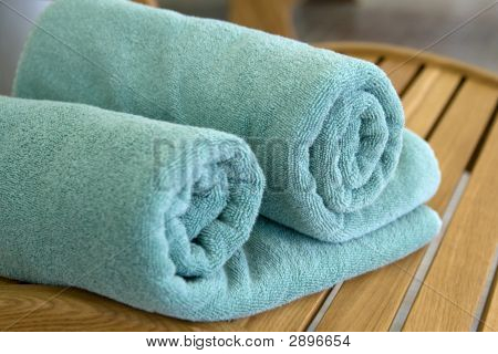 Two Towels Braided In A Tubule On Chair