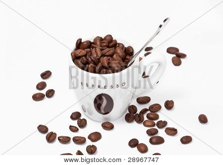 Coffe Cup Full Of Beans And Spoon
