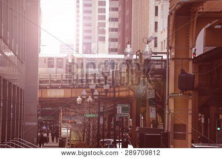 Street With Metro Train Over