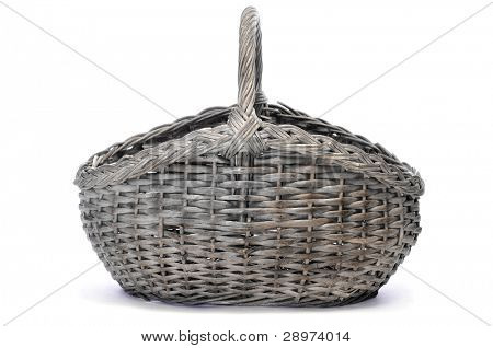 a rattan basket on a white background