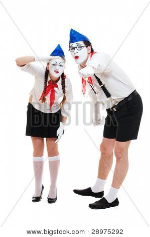 two funny mimes looking at something. isolated on white background