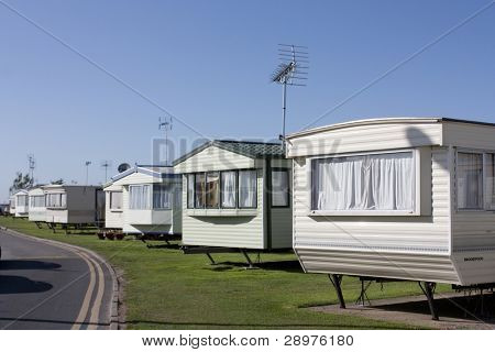 a row of static caravans on a typical british summer holiday park