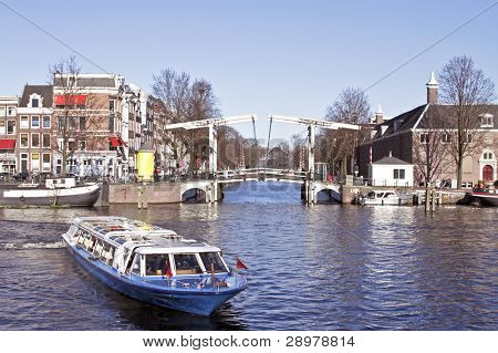 Cruising through Amsterdam on the river Amstel in the Netherlands