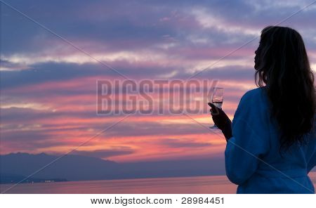 Attractive Woman Looking At Awfully Beautiful Sunset