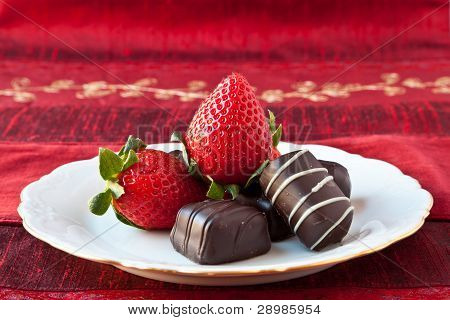 Strawberries And Chocolates On A Plate