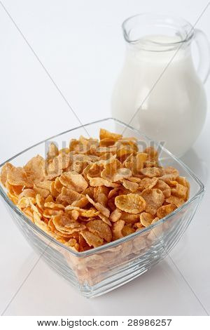 Bowl of cornflakes and milk, close up