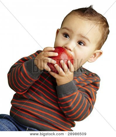 portrait of a handsome kid sucking a red apple over white background