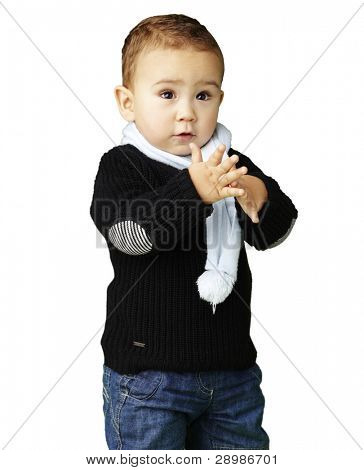 portrait of adorable kid clapping against a white background