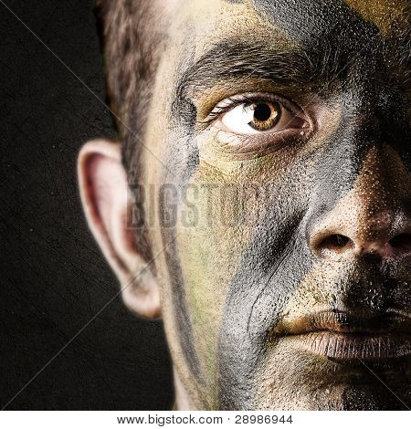 portrait of young soldier face against black background