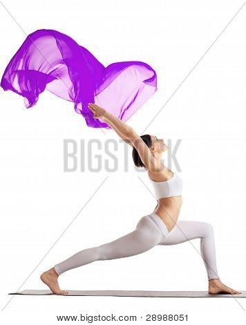 woman stand in yoga purple flying veil isolated
