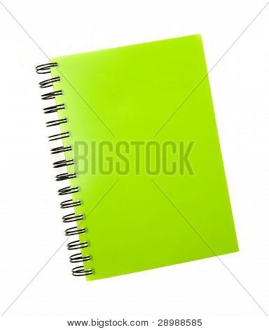 green notebook spiral bound on white