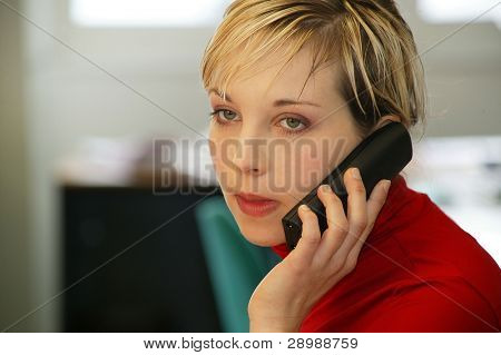 Austere woman talking on the phone