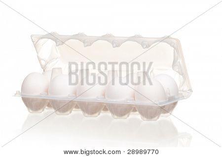 White eggs in the plastic box over white background