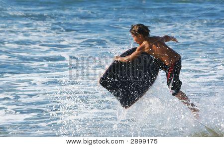Little Boy Cathing A Wave