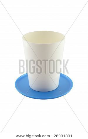 Empty plastic cup and blue saucer