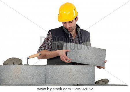 Bricklayer making a block wall