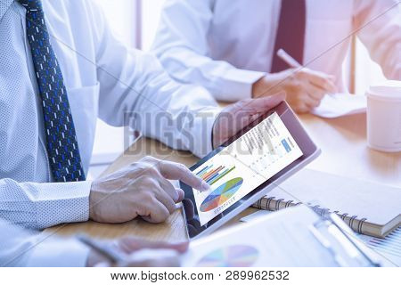 poster of Businessmen Tab On Tablet Touch Screen To Deeply Reviewing A Diagram Or Chart And Financial Reports