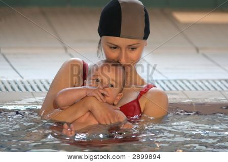Mother With Baby In The Water