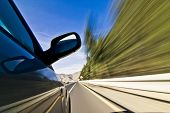 stock photo of speeding car  - Abstract blurred action from car at high speed - JPG