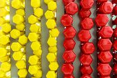Photo Of A Background Of Dumbbells Which Consists Of 50 Of Yellow Of Red Dumbbells A Conceptual Phot poster