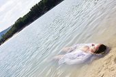 pic of braless  - Young woman floating in nature - JPG