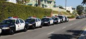 SAN DIEGO, CA - OCTOBER 29, 2008:   Police car-lined street as officers attend the funeral for Feder