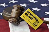 Get Out Of Hell Free Card - yellow playing card with judge's wooden gavel atop US flag