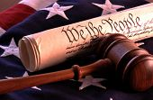 US government - wooden judges gavel, constitutional document and American flag