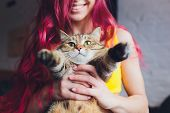 Beautiful Young Woman With Cute Cat Resting At Home. poster