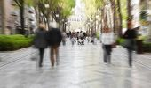 pic of street-walker  - Blurred pedestrian taking a walk in urban background - JPG