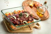 pic of deer meat  - fresh raw deer meat in a glass bowl - JPG