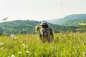 Traveler Girl Relaxing In Meadow In Vacation. Young Girl Traveler Relaxing In Nature. Traveler With  poster