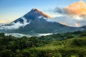 Scenic view of Arenal Volcano in central Costa Rica at sunrise poster