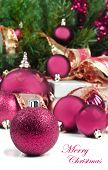 foto of christmas ornament  - Pink christmas decorations under a christmas tree in low light with high contrast - JPG