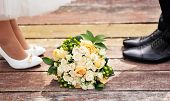 Wedding Bouquet On A Wooden Background.flowering Branch With White Delicate Flowers On Wooden Surfac poster