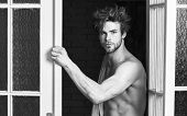 Sexy Macho Tousled Hair Coming Out Bedroom Door. Seductive Lover Full Of Desire. Man Lover Near Door poster